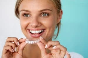 Young woman in West Vancouver holding Invisalign
